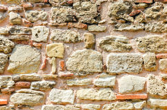 Stone Wall Texture. Old wall consisting of a sandstone and bricks Stock Image