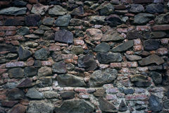 Stone wall texture. Old rock blocks in old medieval brick. Stock Images