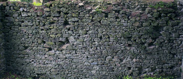 Stone wall texture. Old rock blocks in old medieval brick. Royalty Free Stock Photo