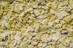 Stone wall texture. Stone Wall Textute Painted on Yellow. Abstract background Royalty Free Stock Photo