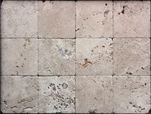 Stone wall texture, travertine tiles facing. Background royalty free stock photo