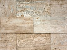 Stone wall texture, travertine tiles facing. Background Royalty Free Stock Image