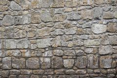 Stone wall for texture tuff. Medieval historical nobody session brown gray Stock Photos