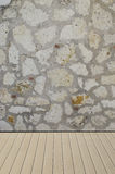 Stone wall texture with wooden floor Royalty Free Stock Images