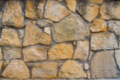 Stone wall texture from yellow stone bricks. Background. Stone wall texture from stone bricks Stock Image