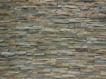 Stone Wall. A stone wall with textured flat stones in gray and light browns Royalty Free Stock Photo