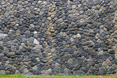 Stone wall in Thailand Stock Images
