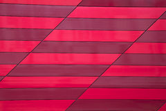 Stone wall tiles  red stripe Royalty Free Stock Photo