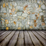 Stone wall and timber floor stock photography
