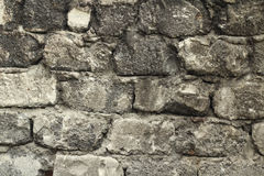 Stone wall with traces of black background Stock Image
