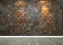 Stone wall with two spotlights and grey wooden floor stock photography