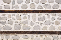 Stone wall with two wooden beams Royalty Free Stock Photos