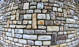 Stone wall using fish eye lens. Granite stone wall taken with fish eye lens stock photos