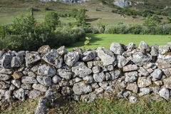 Stone wall in in Valle del Lago. One of fifteen parishes in Somiedo, a municipality located in the central area of the Cantabrian Mountains, Principality of Stock Photos