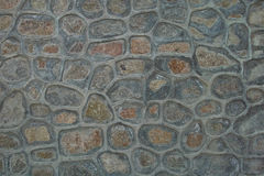 Stone wall texture. Various stone pieces make up colorful rock wall Royalty Free Stock Image