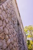 Stone wall of villa Stock Photography