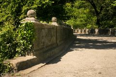 Stone Wall Walk-road in Park of Vorontsov Palace in Crimea. Stone wall and walk-road in park of Vorontsov palace in Crimea Ukraine in springtime royalty free stock photo