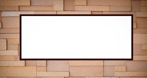 Stone wall with white board. Stock Photo