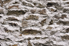 Stone wall with white cement closeup Royalty Free Stock Photos
