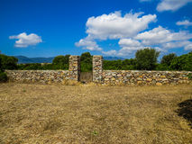 Stone wall and white clouds Royalty Free Stock Photo