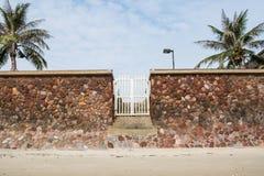 Stone wall white door beach Royalty Free Stock Photos