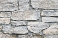 Stone wall. White stone tiles at external wall Stock Photo