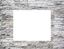 A stone wall with white windows Stock Photography