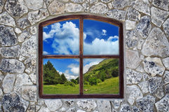 Stone wall with a window Royalty Free Stock Photography