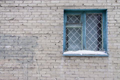 Stone wall and window with lattice Royalty Free Stock Photos