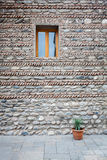 Stone wall with a window Royalty Free Stock Photos