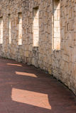 Stone wall with windows on it Stock Images