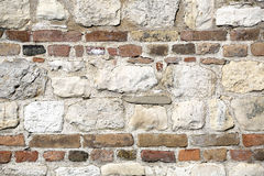 Stone Wall With Red Bricks In Like A Flour Or Ceiling Stock Photo