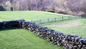 Stone wall and wood fence Royalty Free Stock Images