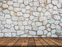 Stone wall on wood floor Room interior Royalty Free Stock Image