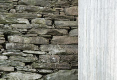 Stone Wall with Wood Siding Background. Royalty Free Stock Photo