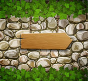 Stone wall with wooden arrow Royalty Free Stock Images