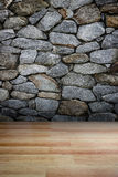 Stone wall and wooden floor Royalty Free Stock Image