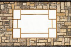 Stone wall with wooden pattern Royalty Free Stock Images