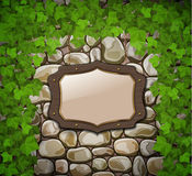 Stone wall with wooden shield Royalty Free Stock Image
