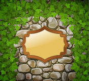 Stone wall with wooden shield Stock Photos