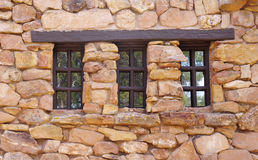 Stone wall with wooden window Royalty Free Stock Images