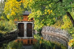 Stone walled canal in autumn Stock Photo