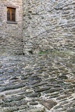 Stone walls and cobble street Stock Photography