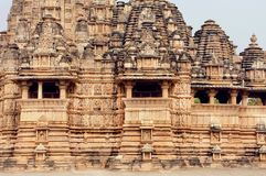 Stone walls of designed in 10th century Hindu temple in ancient Indian city Khajuraho. UNESCO World Heritage Site. stock images