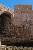 Fortification in El Jadida, Morocco. Stone walls of the former portuguese fortress in El Jadida, Morocco, on the coast of Atlantic ocean. Bright blue sky royalty free stock photo