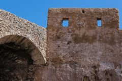 Fortification in El Jadida, Morocco. Stone walls of the former portuguese fortress in El Jadida, Morocco, on the coast of Atlantic ocean. Bright blue sky stock image