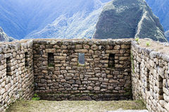 Stone Walls Machu Picchu Peru South America. Inca Stone Walls At Machu Picchu Peru Green Grass And Mountains In Background stock image