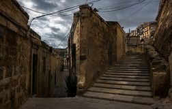 The stone walls of Malta. Valletta. Stairs and corners of the old town of Valletta. Malta. The beauty of the ancient capital stock photography