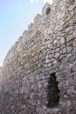 Stone walls of a medieval castle. Town of Consuegra in the provi Royalty Free Stock Photography