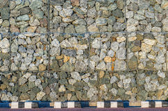 Stone walls prevent landslides in country road. Royalty Free Stock Photography